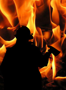 Fireman with Axe Amid Flames