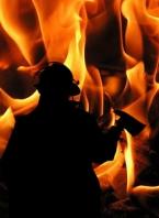 Fireman with Axe Amid Flames